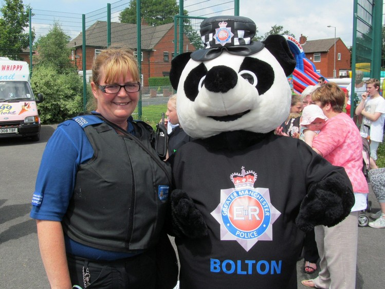 Pcso Michelle with Pippa Panda at the Washacre FM 2014 Showcase Day at the John Holt Centre, Westhoughton